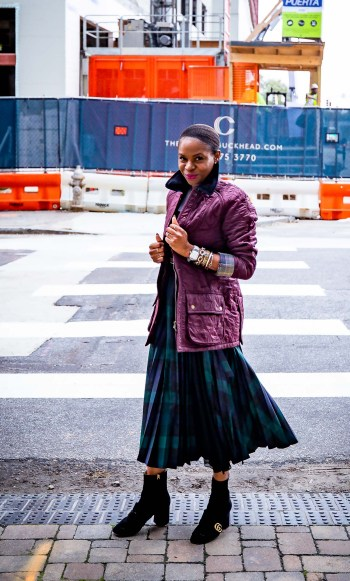 Fashion blogger Monica Awe-Etuk wearing burgundy winter coat from bloomingdales, love tee, plaid pleated midi skirt and gucci booties