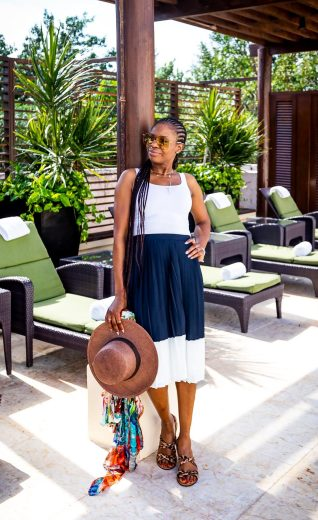 Atlanta lifestyle blogger Monica Awe-Etuk wearing a j.crew pleated midi skirt, white theory tank top, leopard sandals, oversized gucci sunglasses in mexico_-3