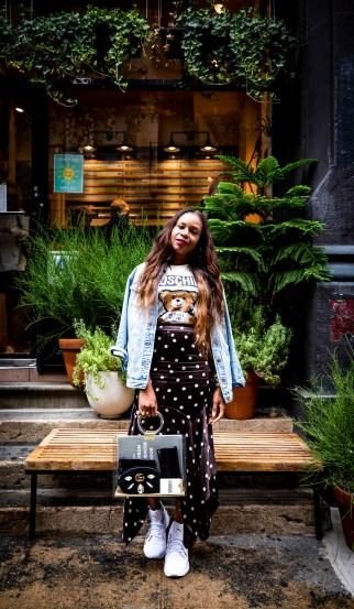 Atlanta blogger wearing moschino t-shirt and ganni polkadot midi skirt and dad sneakersF5A1761-Edit