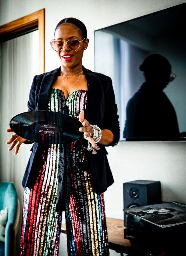 Atlanta fashion blogger Monica Awe-Etuk creates 4 New Year's eve outfits featuring the hottest trends of the season. sequin jumpsuit and velvet blazer, sequin mini dress, leopard wrap dress, and metallic fringe dress
