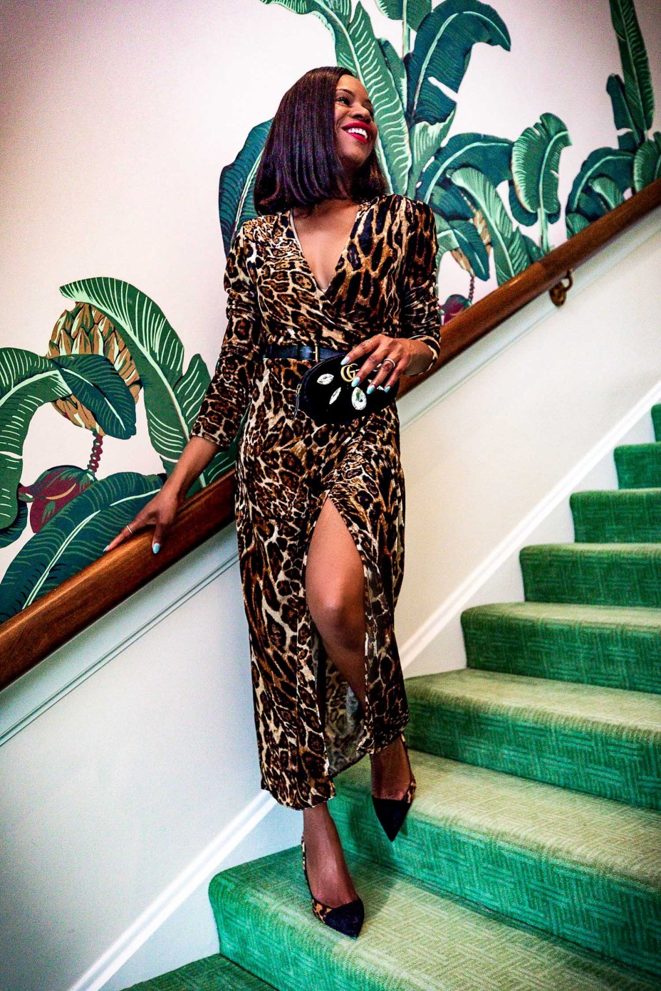 Fashion blogger Monica Awe-Etuk wearing a velvet leopard wrap dress, christian dior leopard pump shoes, gucci belt, gucci clutch at the beverlyhills hotel in LA for New Years Eve 4