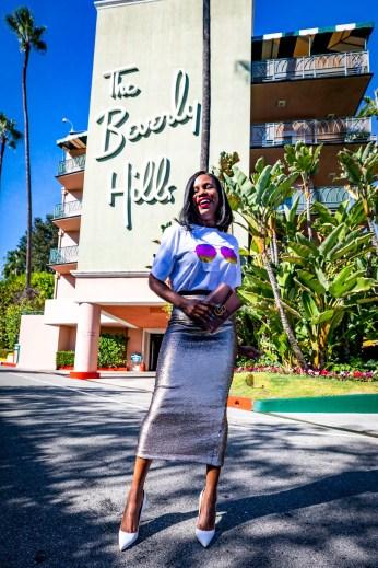 blogger Monica Awe-Etuk wearing a victoria beckham graphic t-shirt, cinq a sept sequins midi skirt, and white manolo blahnik pumps for New Year's Eve-at the beverlyhills hotel in LA-11