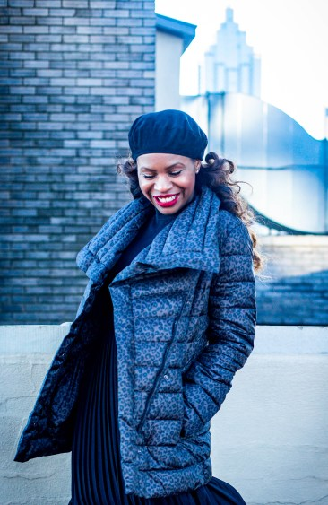 Atlanta fashion blogger Monica Awe-Etuk shows you how to create a closet refresh with stylish, on-trend items on a budget from TJMaxx. Monica wearing a leopard puffer jacket, black pleated dress, black beret, and stuart weitzman combat boots all from TJMaxx