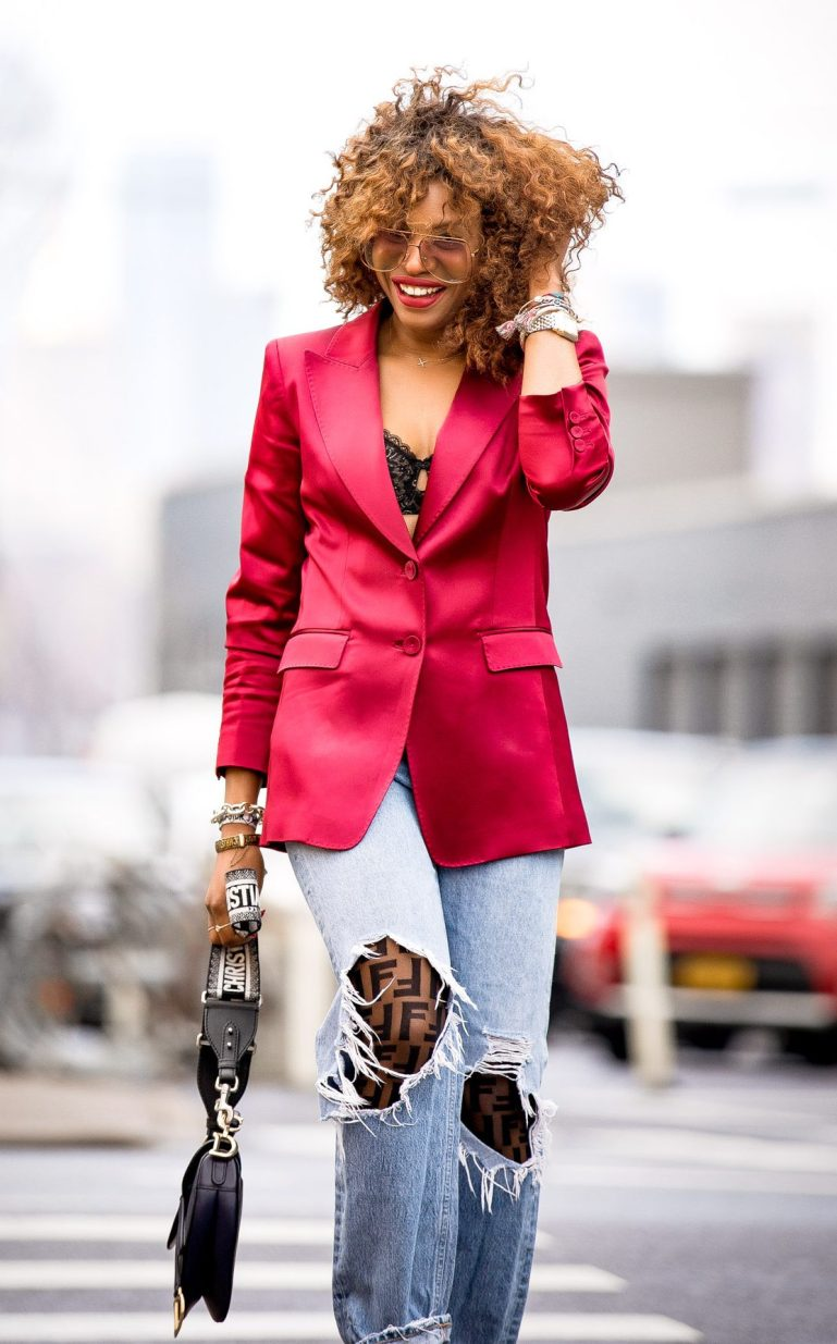 Atlanta fashion and lifestyle blogger Monica Awe-Etuk in NY for NYFW wearing Fendi logo pantyhose, a Lafayette 148ny red satin blazer, agolde ripped jeans, chloe sunglasses, dior saddle bag, and alexandre birman ankle-tie sandals, shows you how to wear logo tights