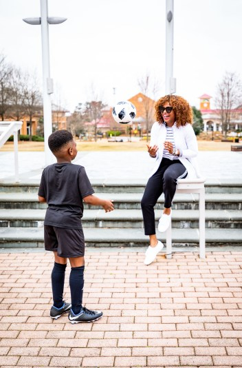 Atlanta lifestyle blogger Monica Awe-Etuk creates 2 stylish mom outfits for soccer moms on the go. Wearing talbots X Oprah collection to drop off her kids for soccer and gymnastics. white and black sports jacket, black crop pants with stripe detail, black and white stripe tee, white superga sneakers, gucci cat-eye sunglasses