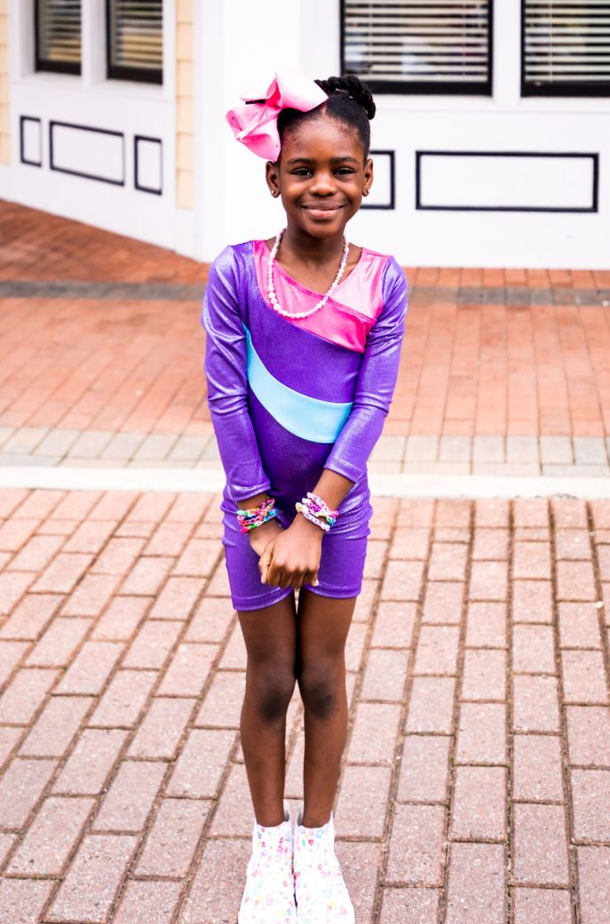 Atlanta lifestyle blogger Monica Awe-Etuk wearing talbots X oprah collection to drop off her kids for soccer and gymnastics. mommy blogger
