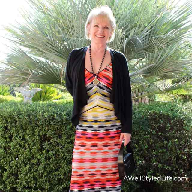 Accessories are an easy way to winterize a colorful sundress.