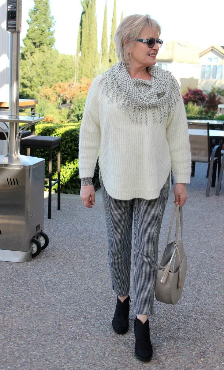 Jennifer Connolly of A Well Styled Life wearing gray accessories with ebony and ivory clothes