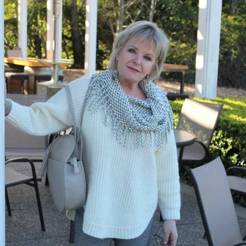 Jennifer Connolly of A Well Styled Life wearing ivory v-neck sweater with gray accessories