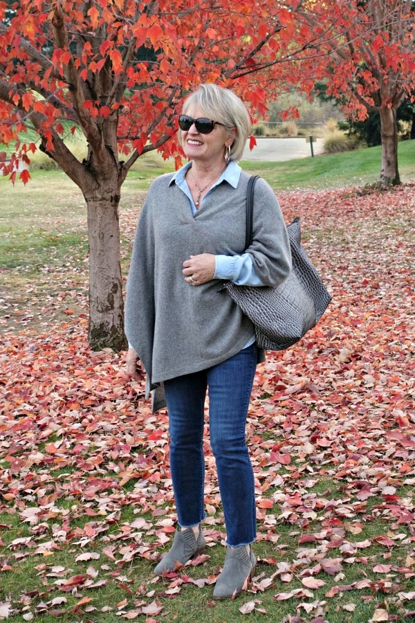 style blogger Jennifer Connolly wearing gray poncho over double denim