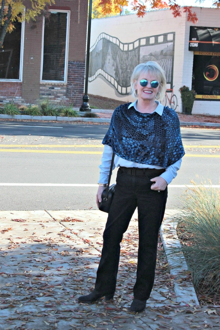 style blogger jennifer connolly from a well styled life wearing velvet cape over chambray shirt and black jeans