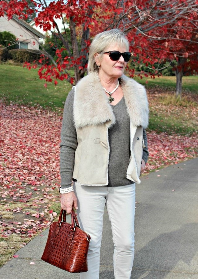 Jennifer Connolly of A Well Styled Life wearing faux fur vest and neutral jeans