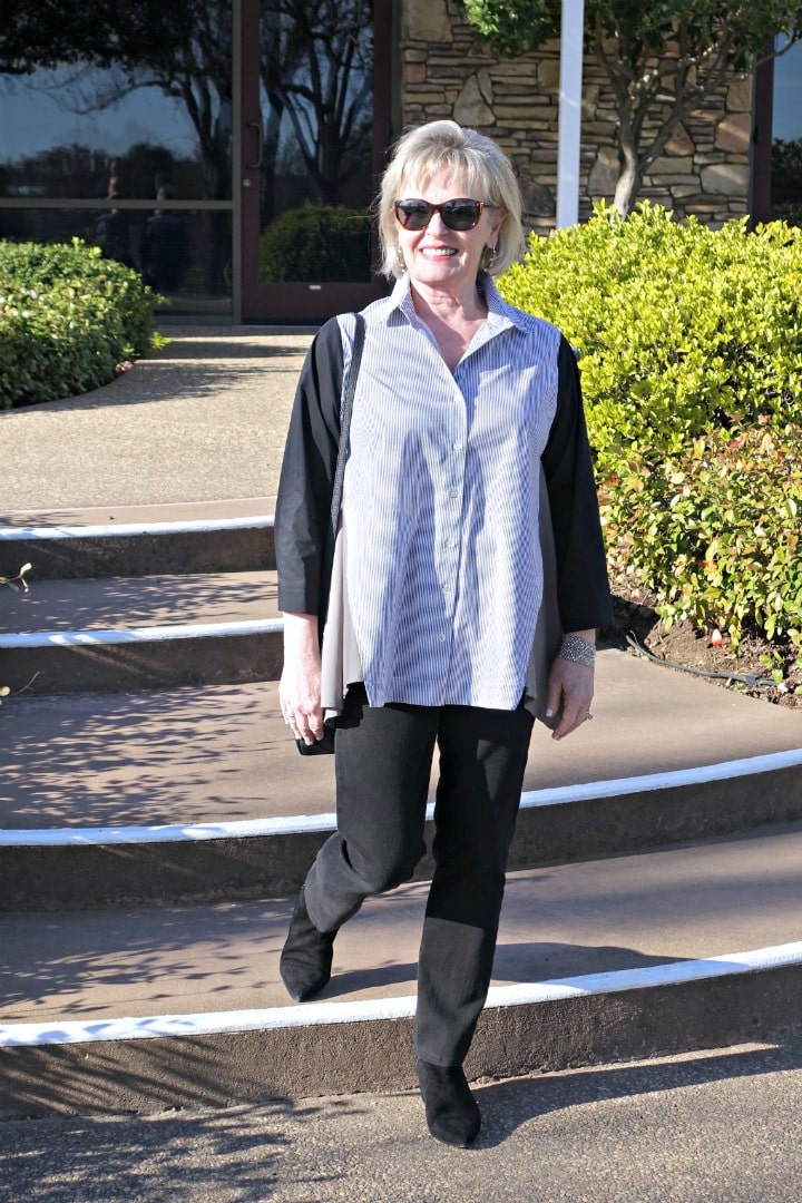 Jennifer of A Well Styled Life wearing stripped tunic by Alembika and black jeans from Artful Home