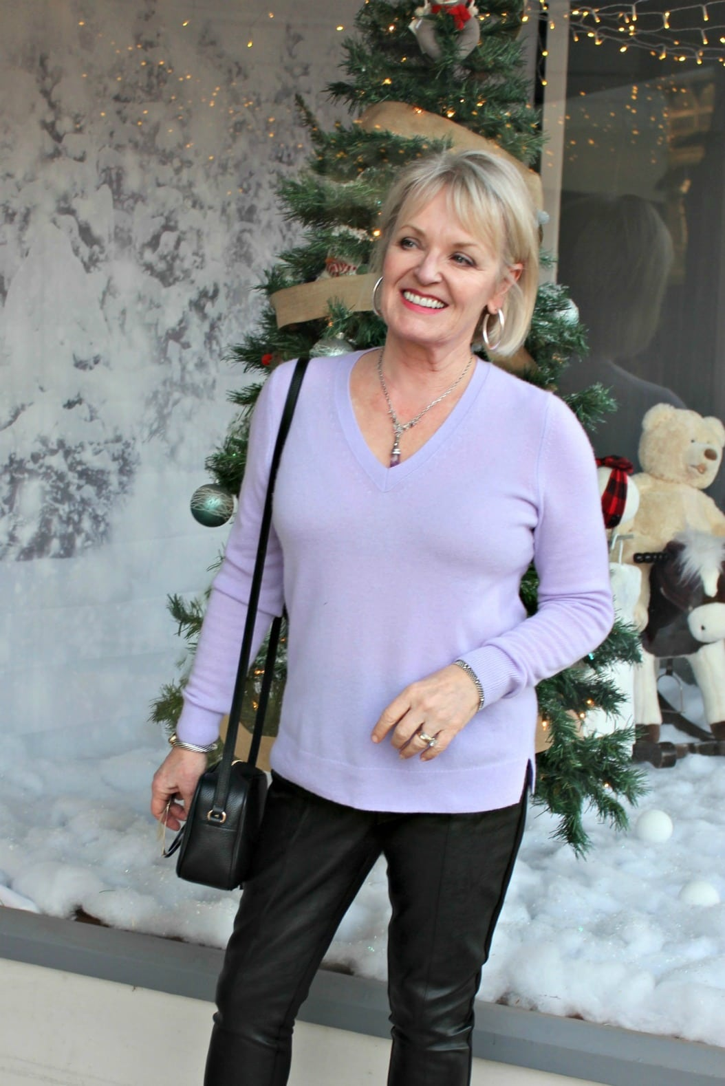 Jennifer of A Well Styled Life wearing lavender cashmere sweater from Ann Taylor