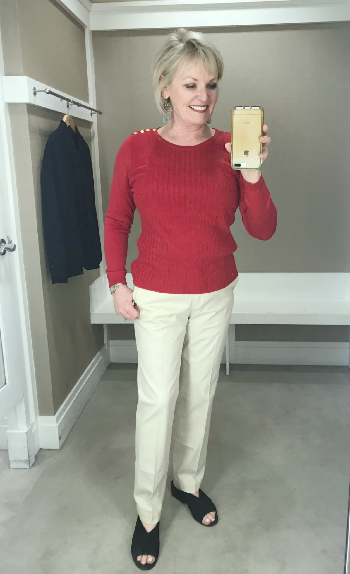 Jennifer of A Well Styled Life wearing red sweater and beige chino's from Talbots