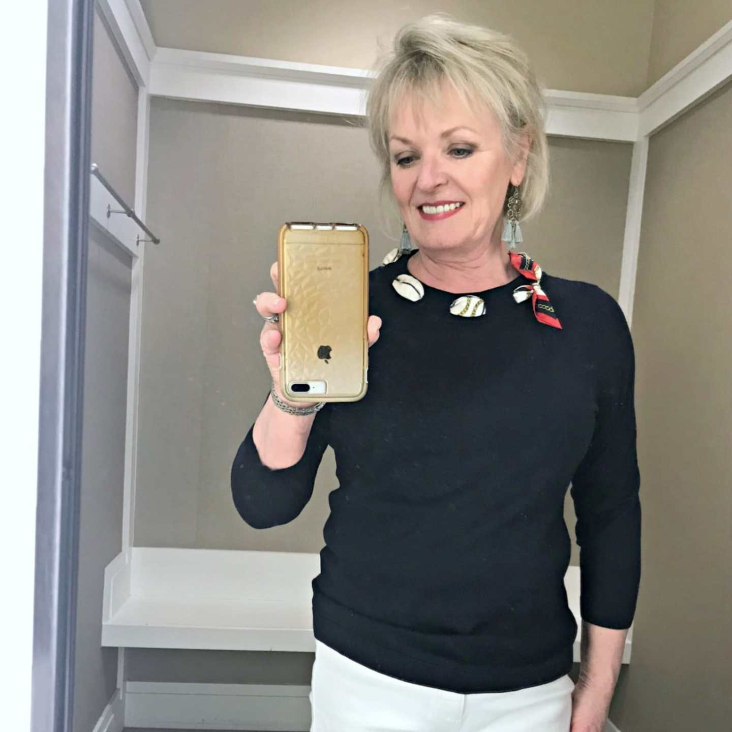 Jennifer of A Well Styled Life wearing Talbots silk tie sweater in navy
