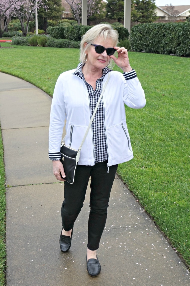Jennifer of A Well Styled Life wearing black and white shirt, black jeans, and black driving moccasin from Talbots