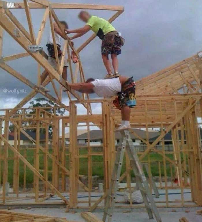 human-stand-on-a-ladder-audacious-workers
