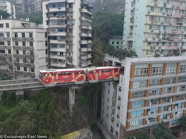train-goes-through-occupied-building-rare-things-pictures