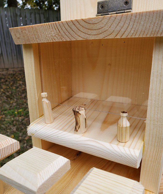 withliftedhandsy wooden outdoor critter feeder