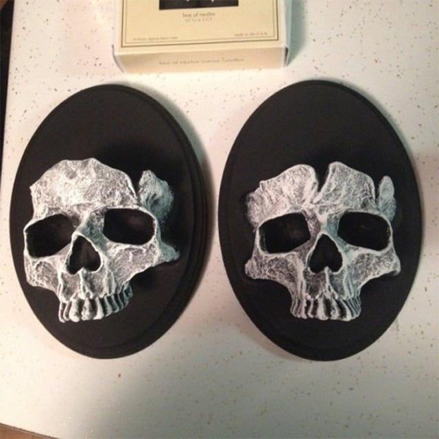 cranium-shaped resin sculpture wall-mounted