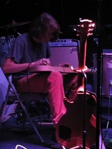 Graham Parsons playing slide guitar with Bathgate - Photo by Jon Miller