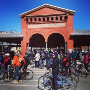 Cyclists gather in front of Shed 2 in Detroit's Eastern Market for Slow Roll Season Opener on Sunday, March 30, 2014.