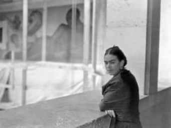 Kahlo overlooking Rivera's murals (courtesy of the DIA archives)