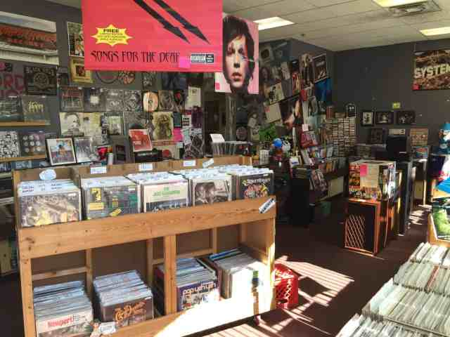 Perusing vinyl at The Record Lounge - Lansing #MittenTrip - The Awesome Mitten