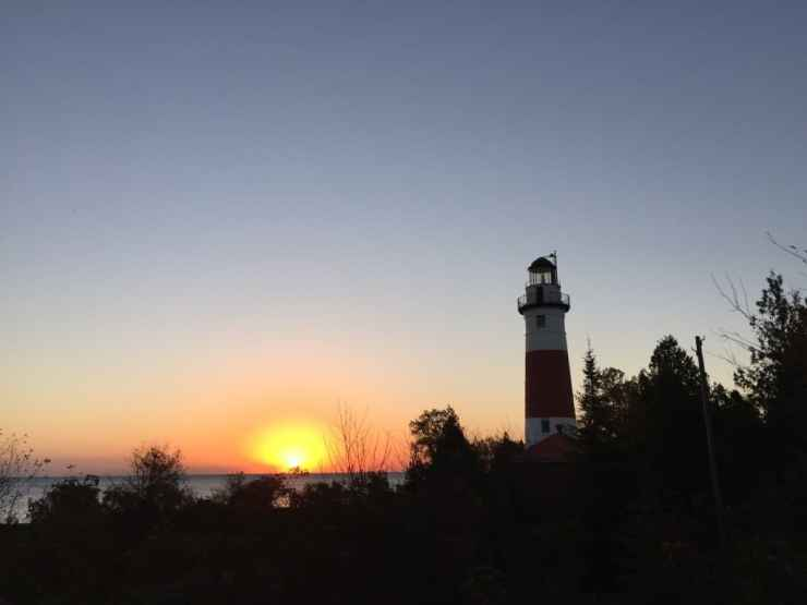 Middle Island Lighthouse at sunrise. Photo by Joel Heckaman - Awesome Mitten #MittenTrip