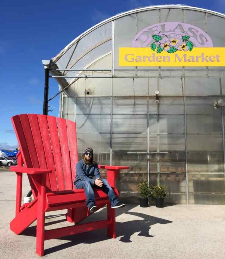 Adam in the giant Adirondack chair at DeLass Garden Market, Spring Lake. Photo by Rhonda Greene.
