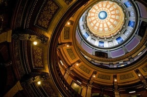 Tour guides often invite guests to lay on their backs and gaze up at the dazzling dome within the Capitol building. Photo by Jonathon Gruenke.