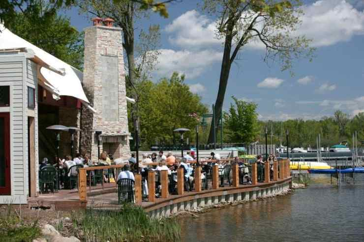 Take in the calming scenery of Reeds Lake from the dockside patio at Rose's Restaurant in Grand Rapids. Photo courtesy of Experience GR