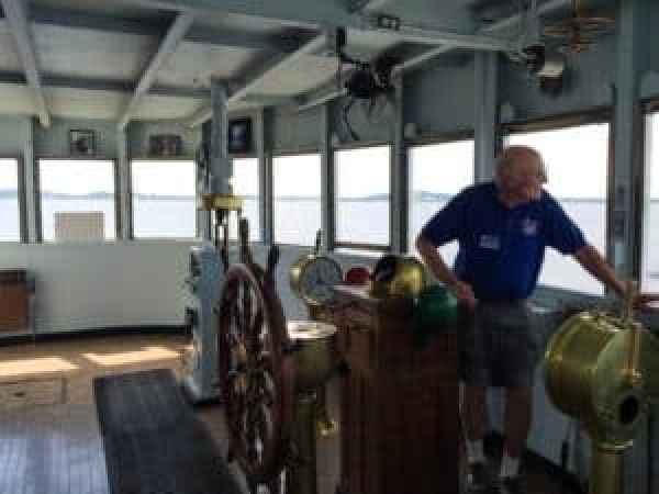 Our guide, Jim Plant, smiling at Muskegon Lake from the Pilot House. Photo courtesy of Jennifer Polasek.