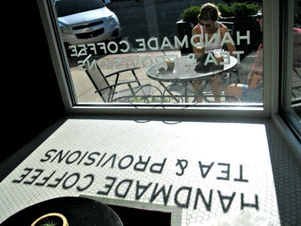 Window reflection at Harless & Hugh. Photo Courtesy of Margaret Clegg