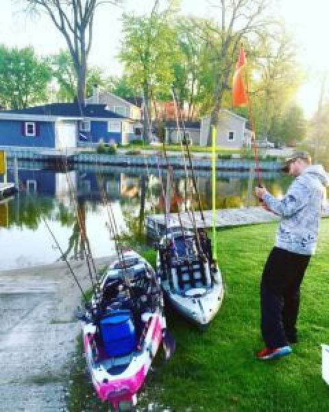 Checking and preparing the kayaks for a day of fishing. Photo by Kellie Olsen