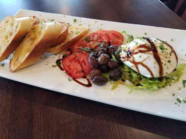 The Tomato Burrata is one of many delicious appetizers at the new Calypso Mediterranean Grill in Traverse City. Photo courtesy of Calypso Mediterranean Grill - The Awesome Mitten