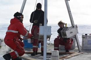 Coring marine sediments in April on the Beaufort Sea