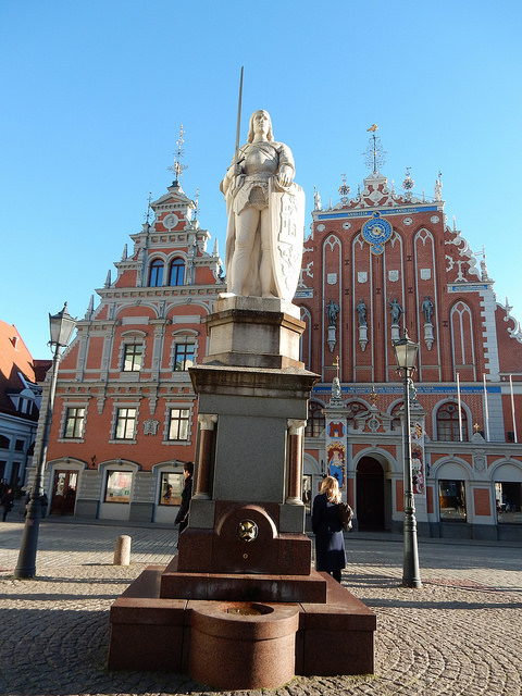 Roland Statue in Town Hall Square in Riga, Latvia. House of the Blackheads in background