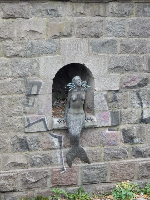 Mermaid sculpture by Romas Vilčiauskas in Uzupis in Vilnius, Lithuania