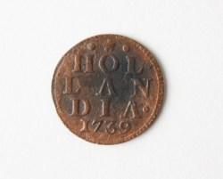 Afb. 9a en b. Koperen duit van 1739 uit de provincie Holland.