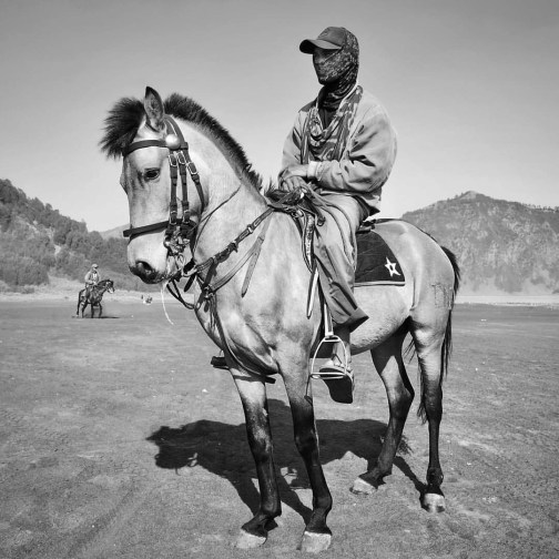 Continuing with Bromo locals, here is one of the guys that helped us reach the crater with his horse. So much respect for them (in Mount Bromo, East Java)