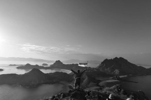 As we trekked all the way up Pulau Padar, we found this Indonesia human proudly waving the country's flag.