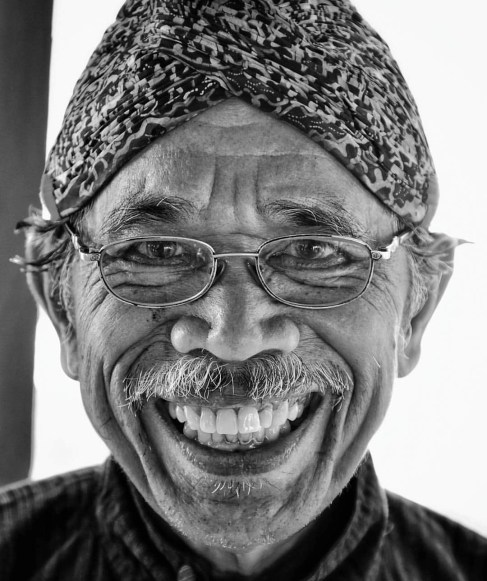 Love stepping into happy people like this man at Jogja's Sultan Palace.