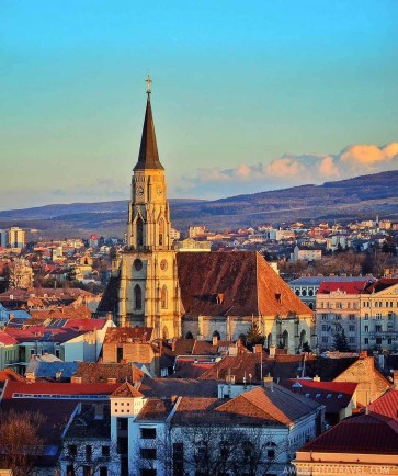 Cluj Napoca cathedral at sunset - A World to Travel