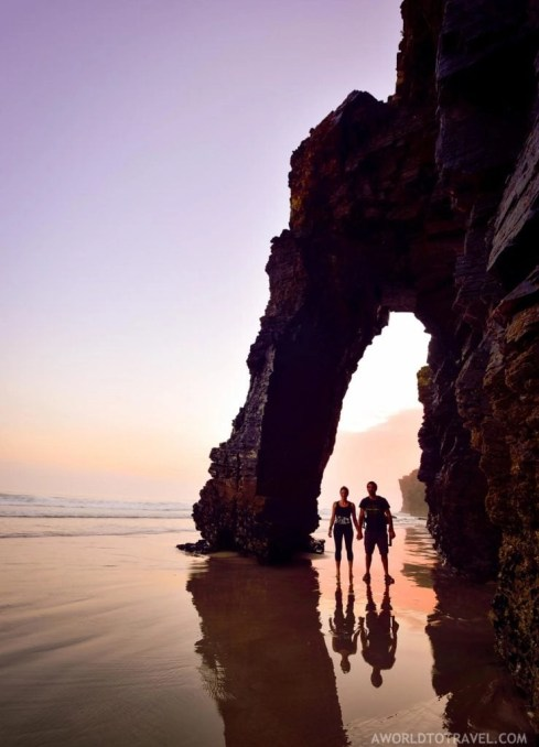 Couple under Cathedrals beach at sunrise - Ribadeo - Galicia - A World to Travel