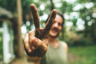 Peace Sign - We Need To Start a Better Conversation About Sustainable and Responsible Tourism - A World to Travel