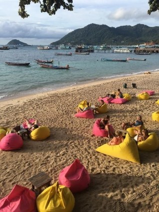 Bean bags in a beach at sunset - Fun Things To Do In Koh Phangan Island Thailand - A World to Travel