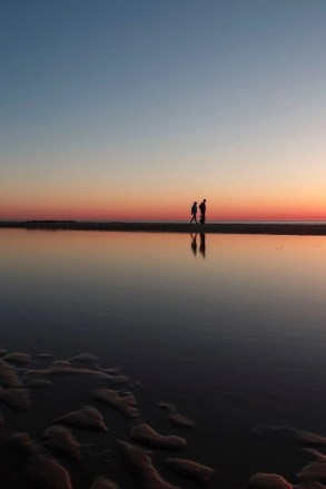 Couple silhouettes at sunset