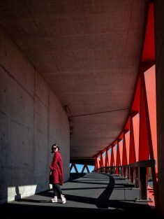 Red fashion editorial - Modern Dutch architecture - A World to Travel